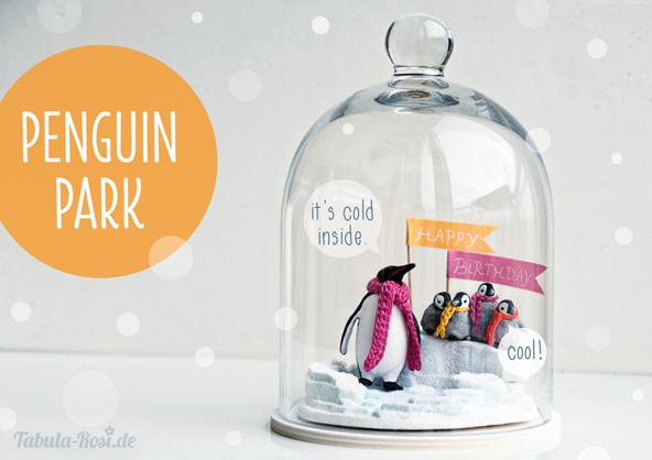 Winterlandschaft mit Pinguinen unter Glashaube